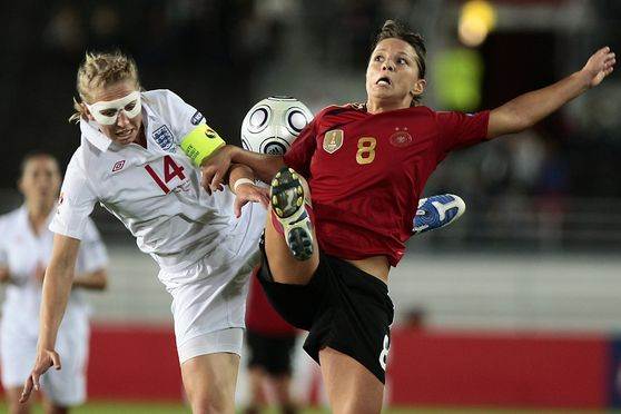INKA GRINGS OF GERMANY (RED) AND FAYE WHITE OF ENGLAND DURING UEFA WOMEN?S EURO 2009 FINAL MATCH ENGLAND-GERMANY AT HELSINKI OLYMPIC STADIUM IN HELSINKI FINLAND 10. SEPTEMBER 2009. GERMANY WON 6-2 (2-1). Photo: Matti Raivio/EASTPRESS