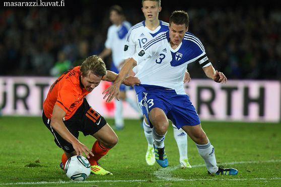 Luuk de Jong of Netherlans (left) and Niklas Moisander of Finland During Finland-Netherland UEFA euro 2012 Qualifers 6th Septemper 2011 at Olympic Stadium in Helsinki Finland.